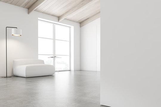 Attic living room corner with armchair
