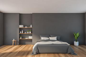 Modern gray bedroom with bookshelves