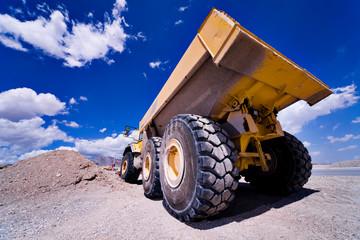 Heavy Construction Equipment Dump Truck against a blue sky