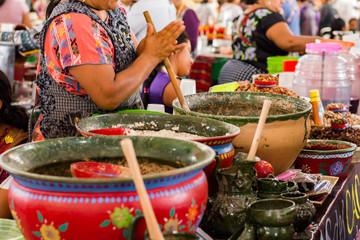 Fototapeta Mexican woman cooking a traditional dish obraz