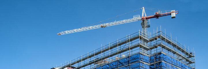 Construction crane on a highrise building construction site. Gos