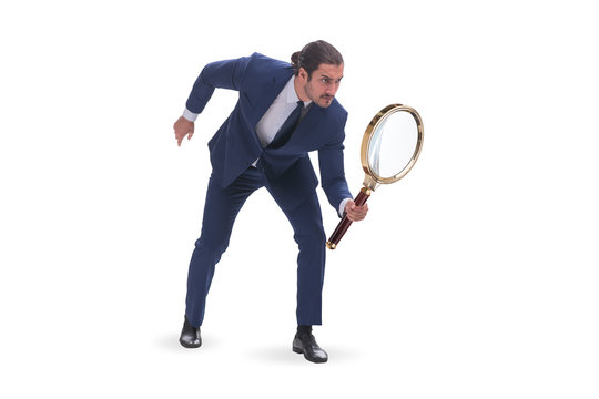 Businessman with giant magnifying glass