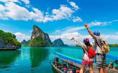 Foto auf Leinwand Blau Happy couple traveler joy fun beautiful nature scenic landscape Phang-Nga bay, Adventure landmark travel Phuket Thailand, Tourist people on summer holiday vacation trip, Tourism destination place Asia