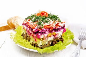 Wall Mural - Salad with beef and vegetables on light wooden table