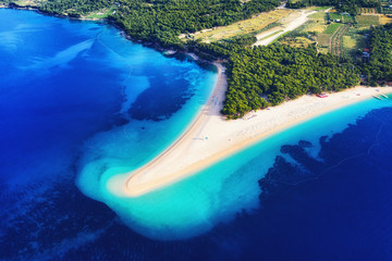 Croatia, Hvar island, Bol. Aerial view at the Zlatni Rat. Beach and sea from air. Famous place in...