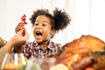 Thanksgiving Celebration Tradition Family Dinner Concept.family having holiday dinner and cutting...