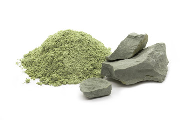 Green cosmetic clay in pieces and powder