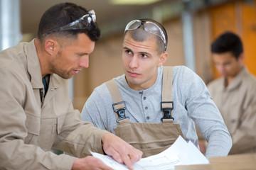 two men in carpentry workshop