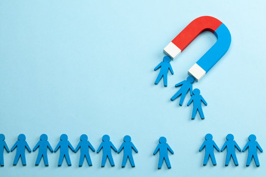 Personnel recruitment and a magnet attracts good employee leaders. Blue background