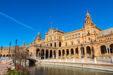 Building and river at the Spain Square (Plaza de Espana) in Seville (Sevilla) city, Andalusia, Spain. Example of Renaissance revival architecture. Bright Sunny day