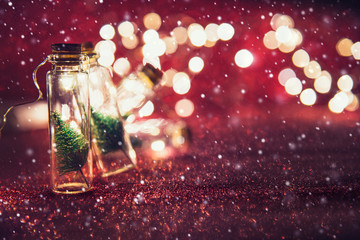 Fototapete - Close-up, Elegant Christmas tree in glass jar on glitter with snowflakes background. copy space.