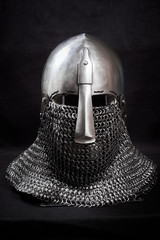 Knight helmet on a black background. Front view.