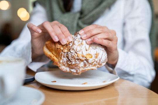 woman eating freash baken croissant