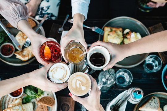 friends toasting at brunch table