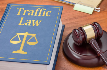 A law book with a gavel  - Traffic law
