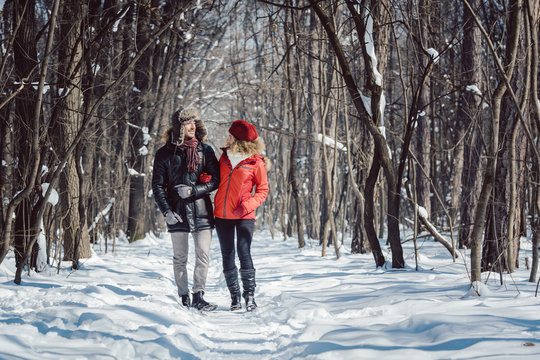Woman and man enjoying winter in the snow