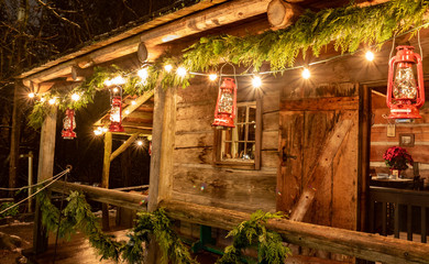 Tiny and Cozy house Cabin Exterior with Christmas lights. Ideal picture that brings up holiday spirit.