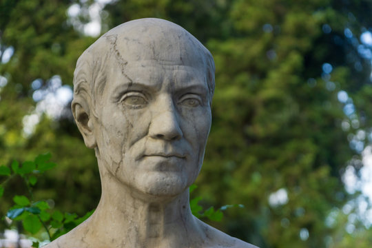 Old marble bust of Archimedes of Syracuse in the public park Pincian Hill, Villa Borghese gardens, Rome, Italy