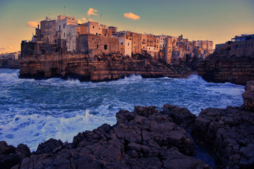 Evening winter scenic sight in Polignano a Mare, Bari Province, Puglia region in southern Italy. Creative image.
