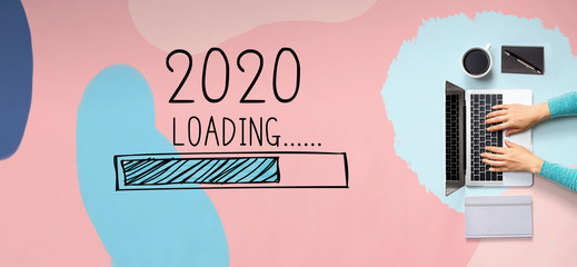 Loading new year 2020 with person using a laptop computer