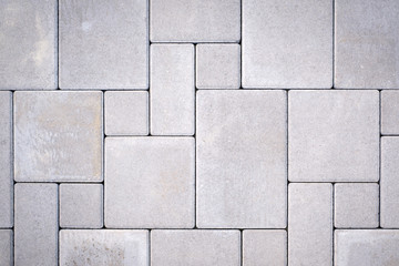 Photo sur Aluminium Cailloux Laying gray concrete paving stones on house courtyard
