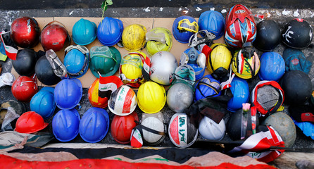 Helmets of the demonstrators who were killed during the ongoing anti-government protests are seen in Baghdad