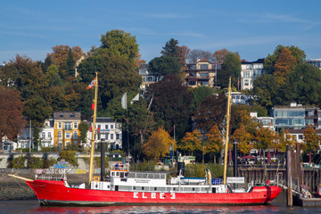 Lightvessel Elbe 3, a historic lightship, anchoring at the river bank of the Elbe river in the harbour of Hamburg, Germany.