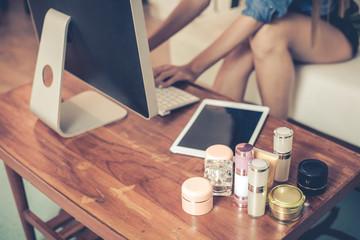 Online merchants selling on social media via computer.