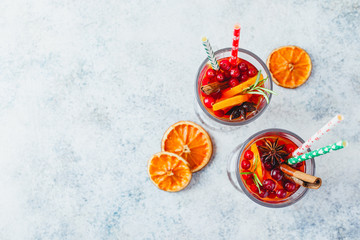 Orange and cranberry drinks with orange slices and spices. Hot drinks for winter and Christmas