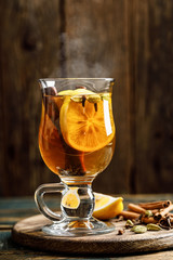 Grog. Hot drink for winter or autumn. Spicy tea and rum cocktail with lemon, cardamom, cinnamon and cloves.