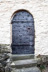 Strong black iron castle door on ancient German Castle