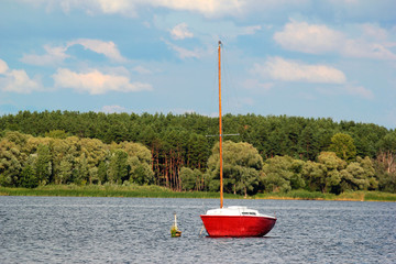 Old red yacht on a river