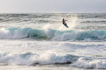 sea surf with surfer on the North Shore, Oahu, Hawaii