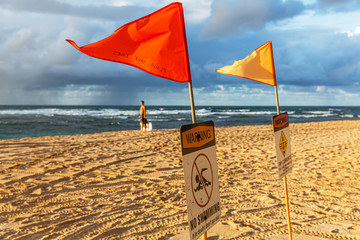 flags on a beach at the North Shore of Oahu, Hawaii