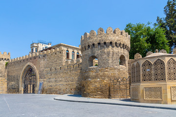 Central entrance and the fortress wall with the tower of the old city of Icheri Sheher