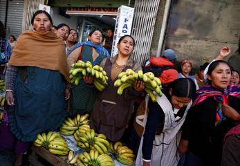 Vendors of bananas protest against interim Bolivia's President Jeanine Anez at a street market in La Paz