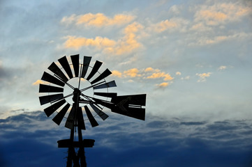 Rural Windmill and Clouds at Dusk