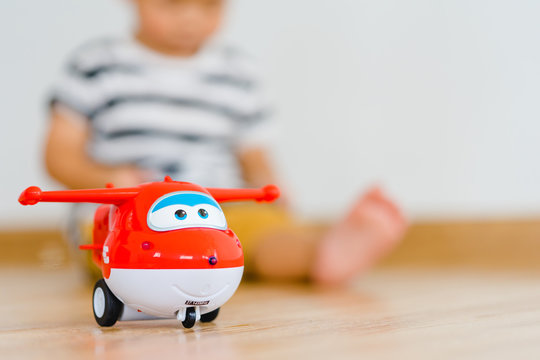 BANGKOK, THAILAND - MARCH 05,2019: Jett by Super Wings Toy.Little baby boy watching cartoon movie in Netflix at home.Super wing is favorite cartoon in Netflix.