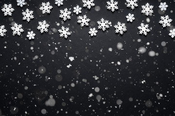 Snow flake texture and falling snow on black background