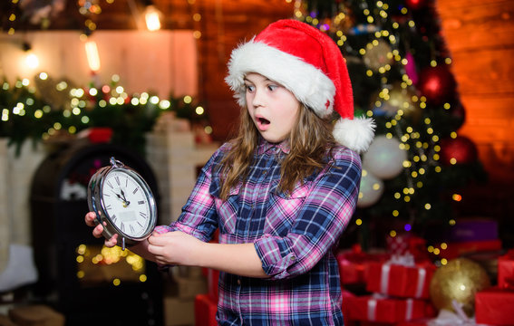 Festive atmosphere christmas day. New year countdown. Counting time. Few minutes till new year. Magic moment is coming. Christmas almost here. Girl santa claus hat and clock. Meet Christmas holiday