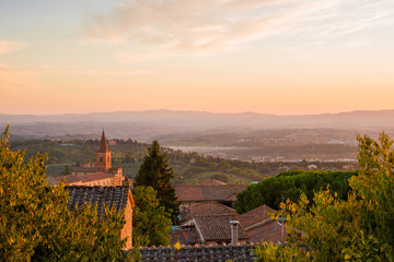 Beautiful sunset sky with evening haze over Umbria countryside seen from the city of Perugia
