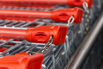 shopping cart with red handle and lock
