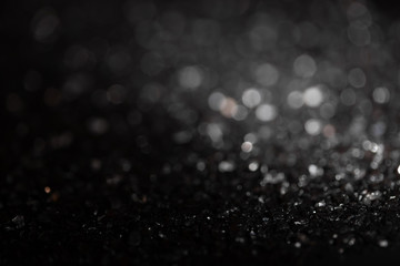 Monochrome vintage abstract background with bokeh defocused lights.