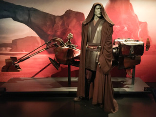 Costume of Anakin Skywalker and a vehicle star wars identities exhibition