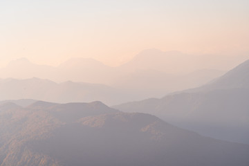 Sunset in the mountains. Mountain view in the fog