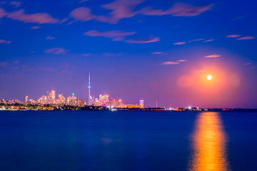 View of Toronto skyline and Lake Ontario from Humber Bay Park area during night time.