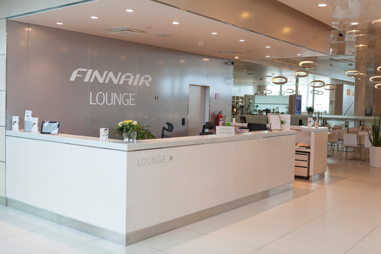 HELSINKI, FINLAND-CIRCA APR, 2013: Reception is on entrance to lounge for vip clients of FinnAir airline at Helsinki Airport. Finnair is largest airline of Finland