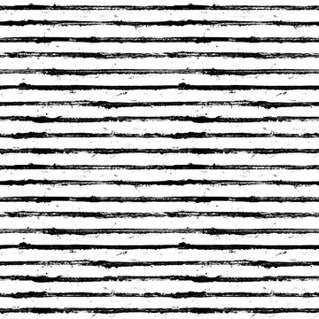 Black and white stripe grunge seamless pattern. White stripes on black background
