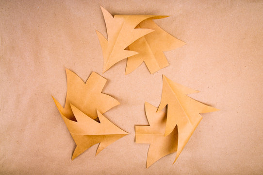 Simple recycling symbol made of Christmas tree shapes in eco-friendly brown paper