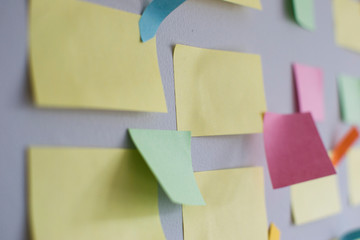 Kanban Board with different colored sticky note papers used in agile methodology for different  business areas